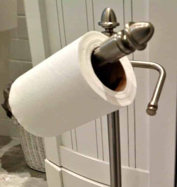 Toilet paper stand with pivot bar.