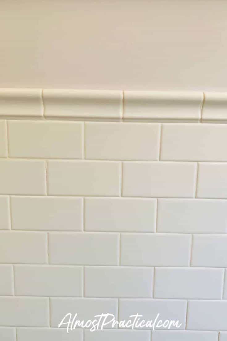 white subway tile wainscoting in bathroom