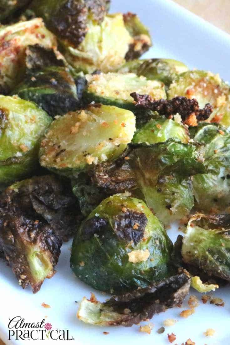 This parmesan encrusted roasted brussels sprouts recipe is a healthy side dish that will have the kids asking for more vegetables.
