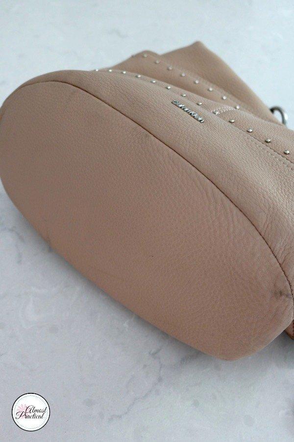 The bottom gusset on a hobo bag.