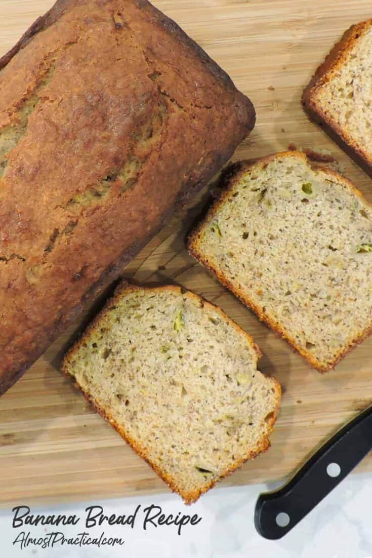 banana bread on cutting board with knife