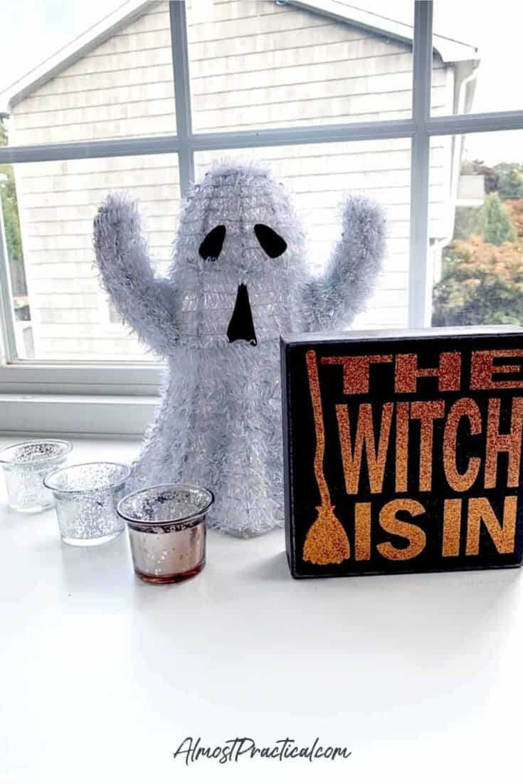"halloween decor - ghost with a ""the witch is in"" sign"