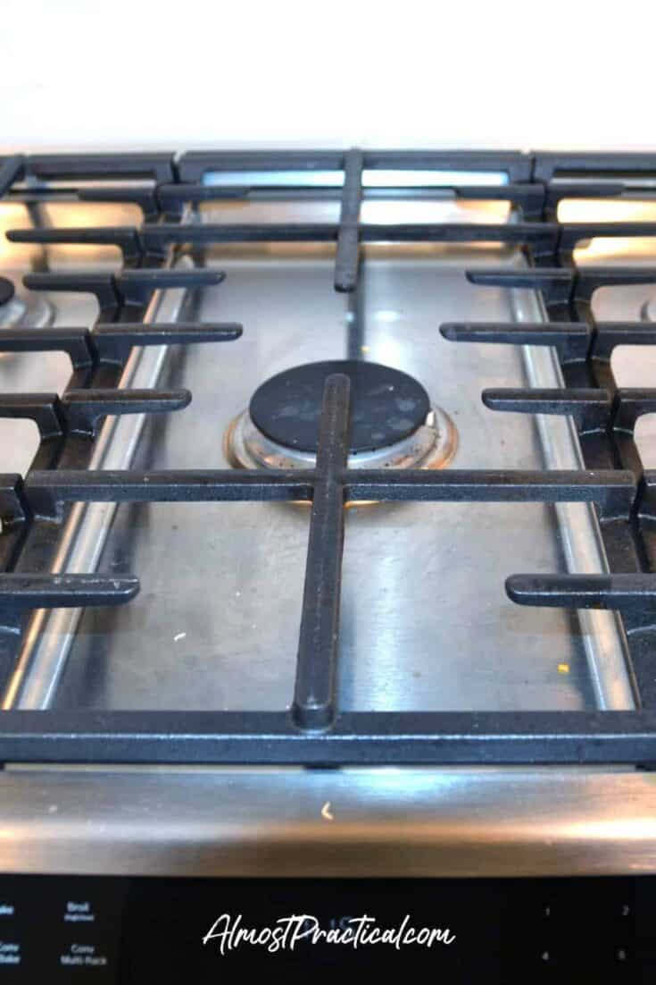 photo of dirty cast iron stove grates