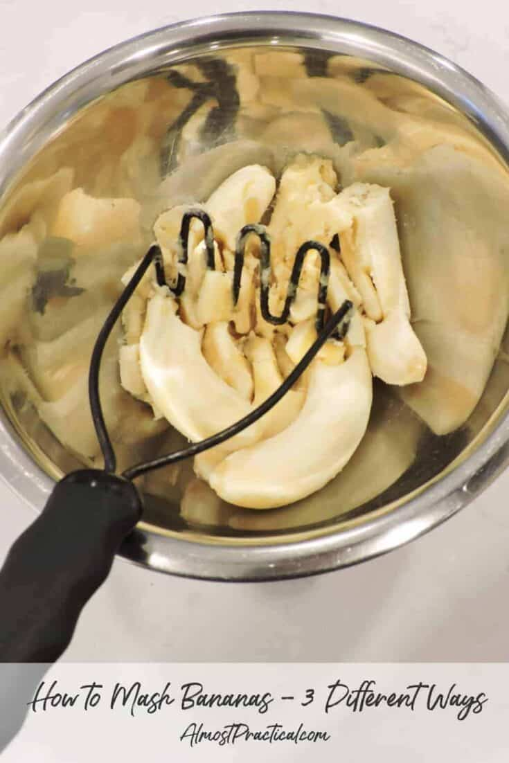 photo of bananas in mixing bowl being mashed with potato masher.