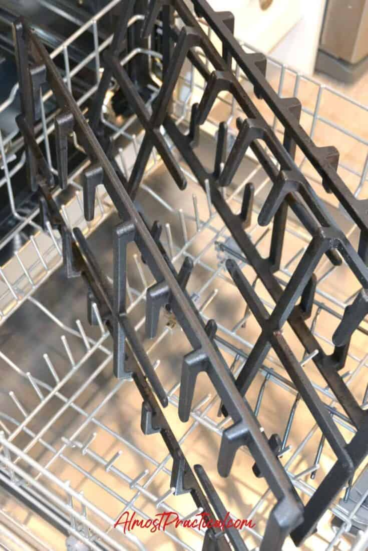 photo of large stove grates on bottom rack in dishwasher