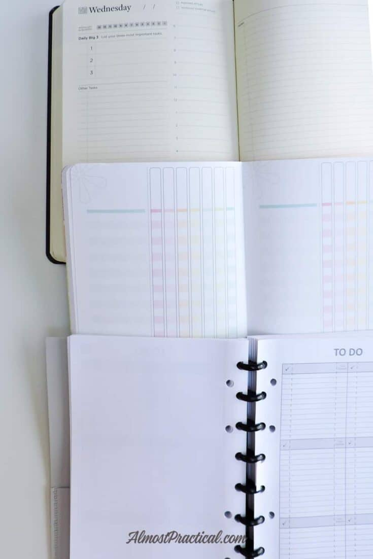 A selection of 3 different planners - the Full Focus Planner by Michael Hyatt, the Erin Condren Checklist Petite Planner, and the