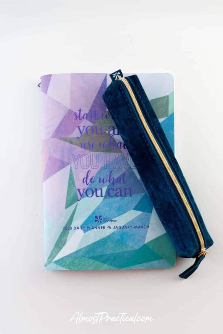The Erin Condren Sapphire blue velvet pencil pouch on top of one of the Daily Planner Petite Planners.