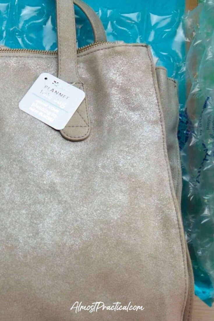 photo of the Erin Condren Metallic Suede Planner Tote in the box