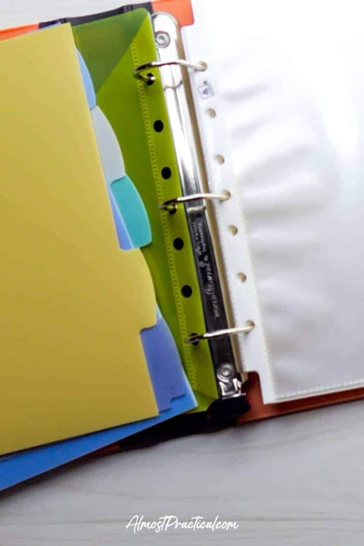 binder open to rings with dividers and sheet protectors shown