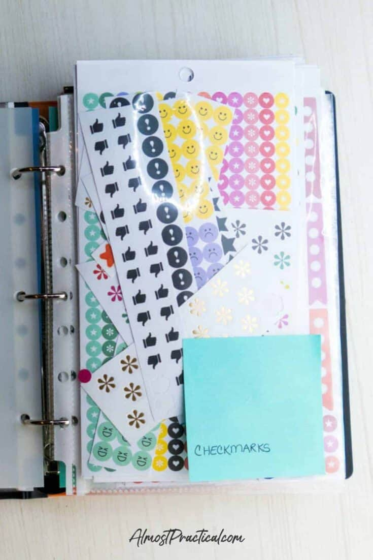 a collection of Happy Planner Stickers in a sheet protector in a binder
