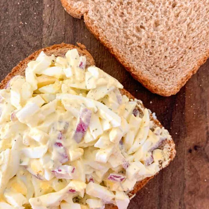 open face egg salad sandwich on wheat
