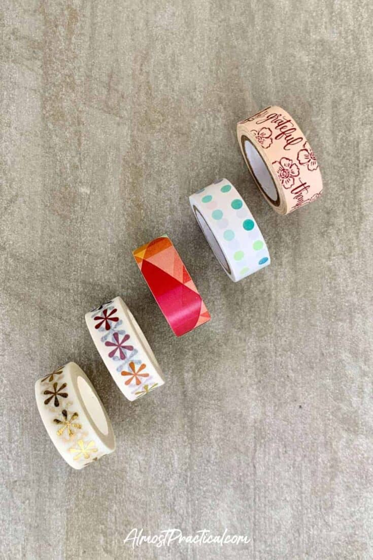 Five rolls of Erin Condren washi tape.