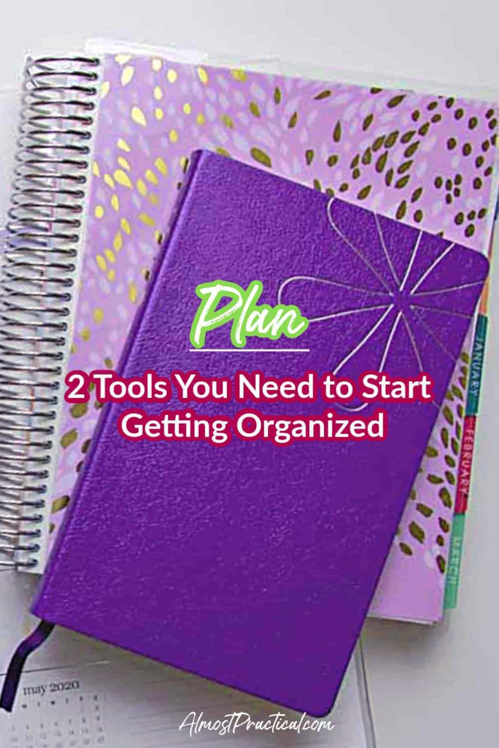 purple planner with notebook on top