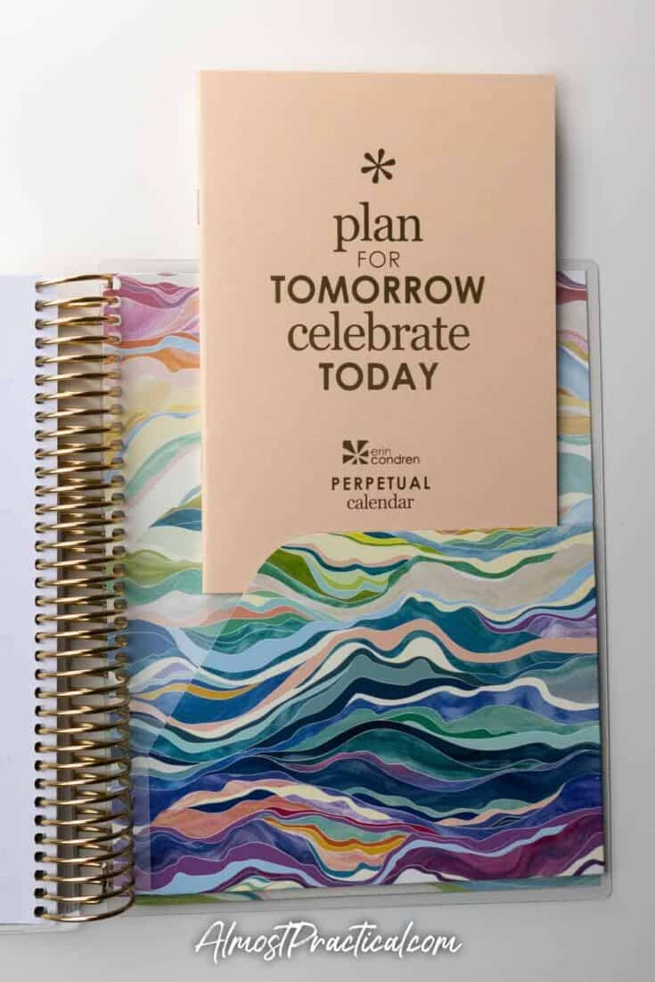 The Perpetual Calendar and folder in the back of the Erin Condren Coiled LifePlanner in the colorful Layers design.