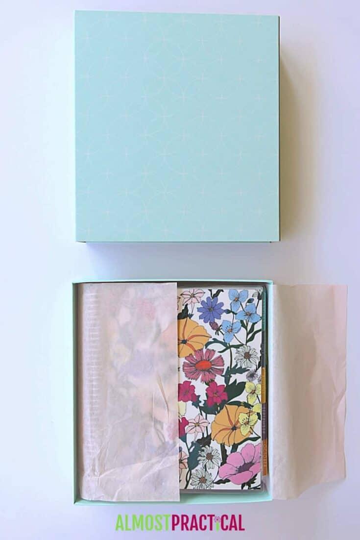 Erin Condren Flower Power LifePlanner inside decorative storage box.