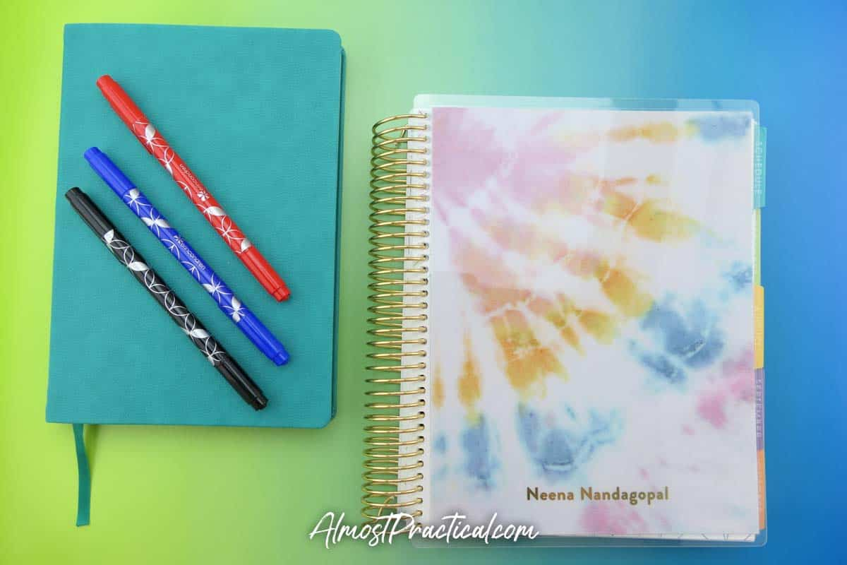 Erin Condren softbound and coiled academic planners side by side