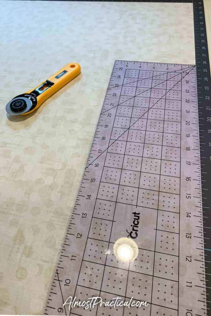 fabric on a cutting mat with a ruler and rotary cutter