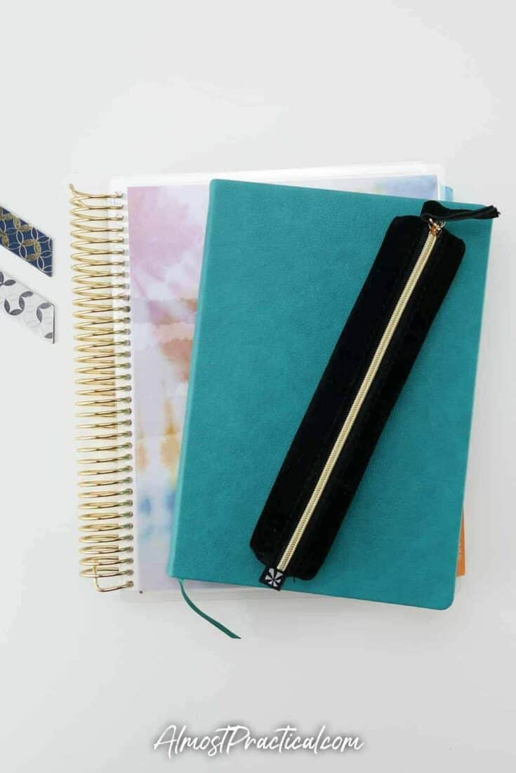 Erin Condren pencil pouch, softbound academic planner, and coiled planner.