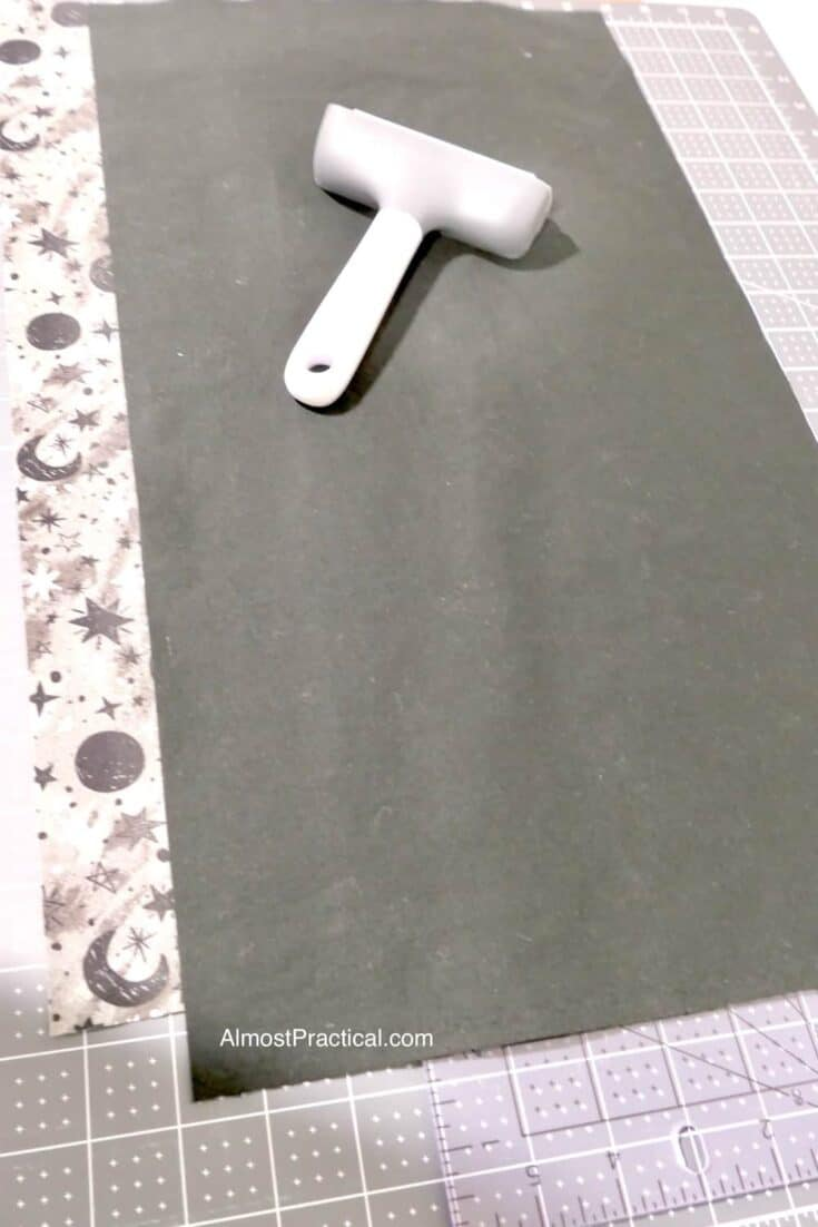 fabric and brayer on cutting mat