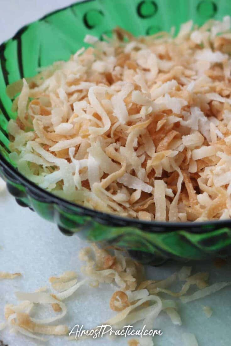 toasted coconut in a vintage green glass bowl