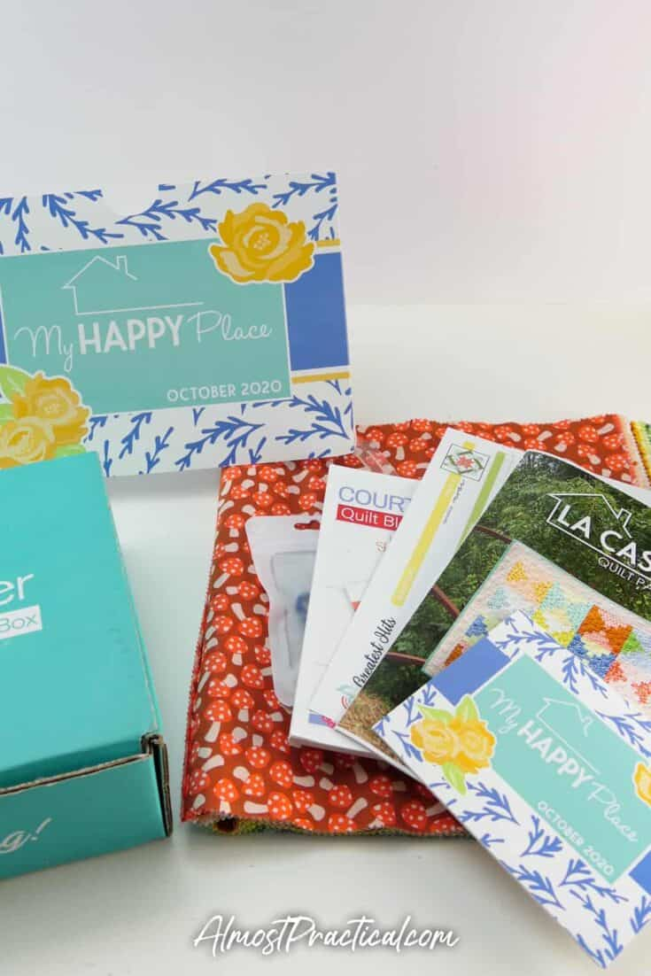 Collection of quilting tools, fabrics, and patterns that were included in the Sew Sampler Subscription Box for October 2020.