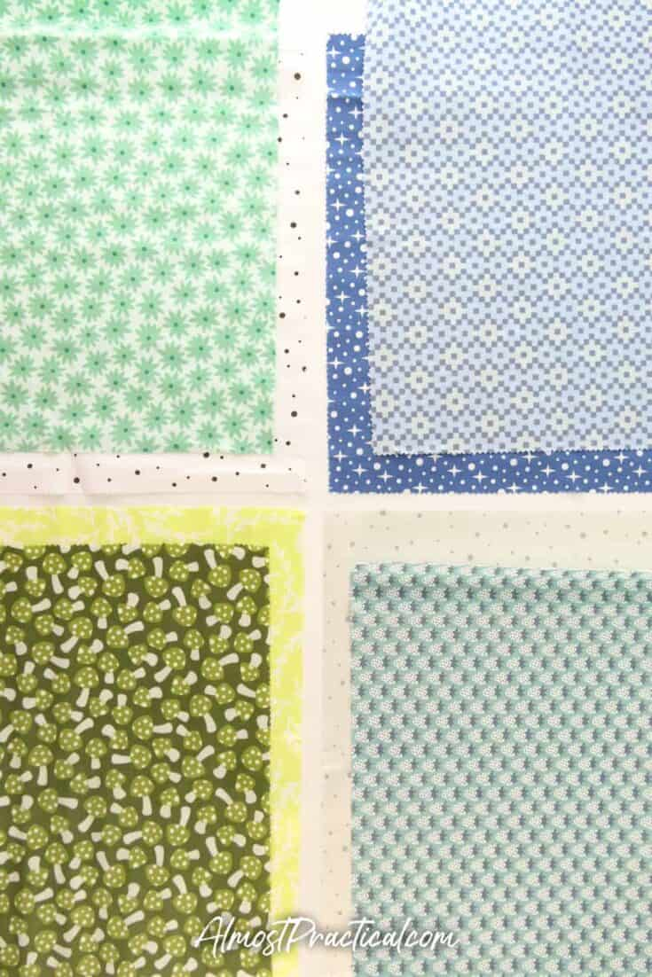 set of 8 fabrics in blues and greens