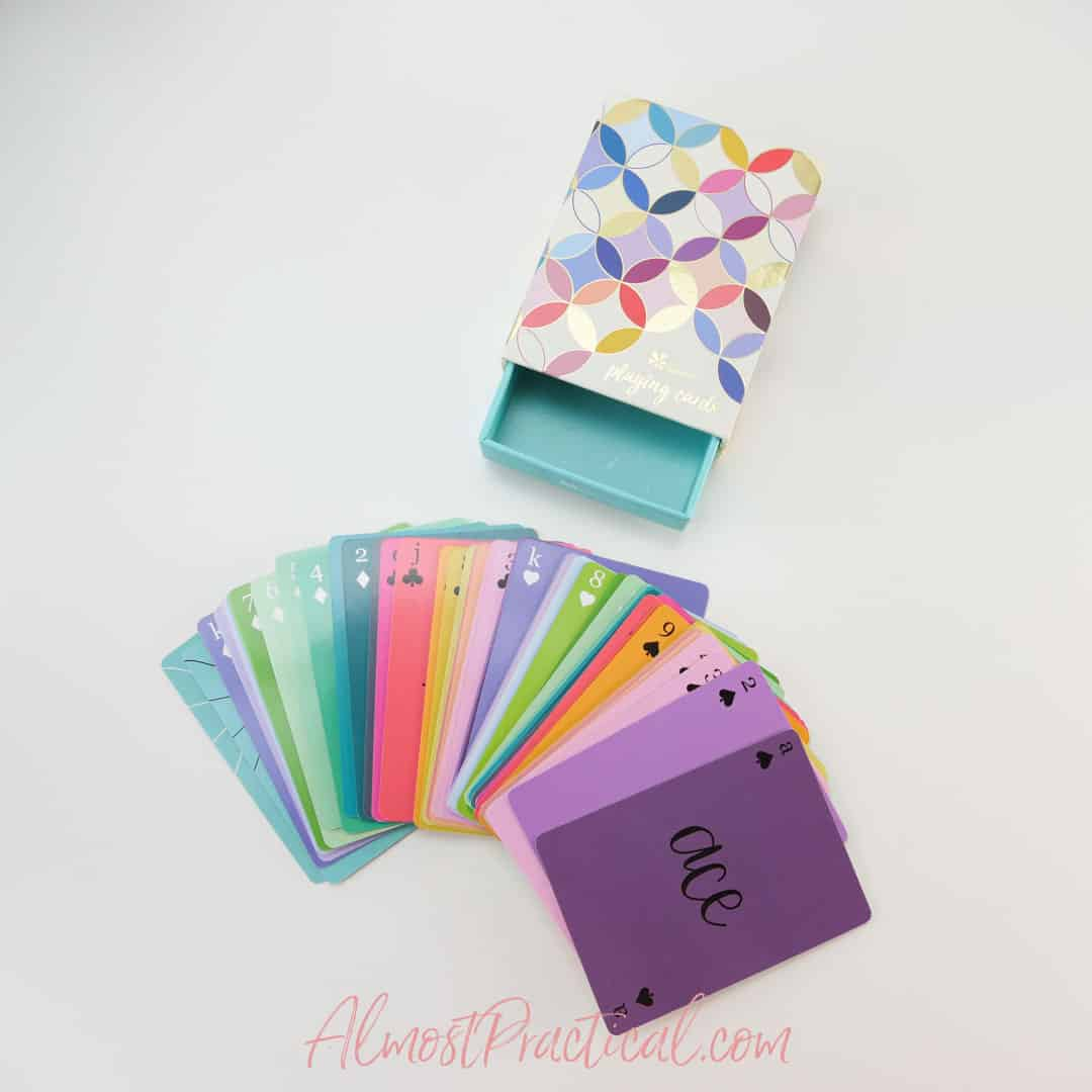 colorful playing cards and box