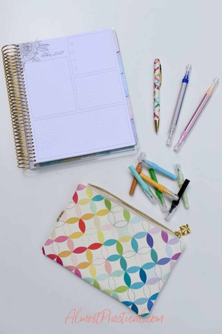 collection of Erin Condren planners and accessories