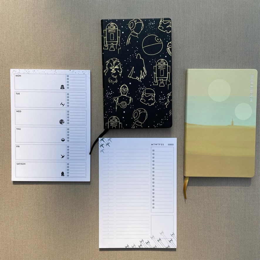 a set of note pads and Erin Condren Softbound notebooks featuring the Star Wars theme
