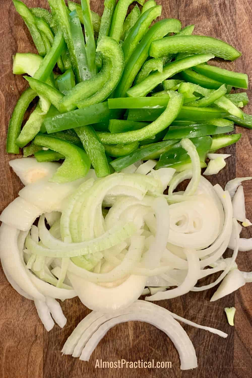 thin strips of sliced fresh onions and green peppers