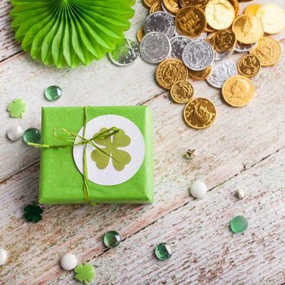 Gift wrapped in green paper with a four leaf clover card on top