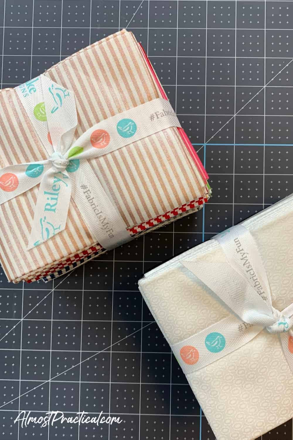 2 fat quarter stacks of fabric in strips and white tied with ribbon from Riley Blake and sold at Cricut