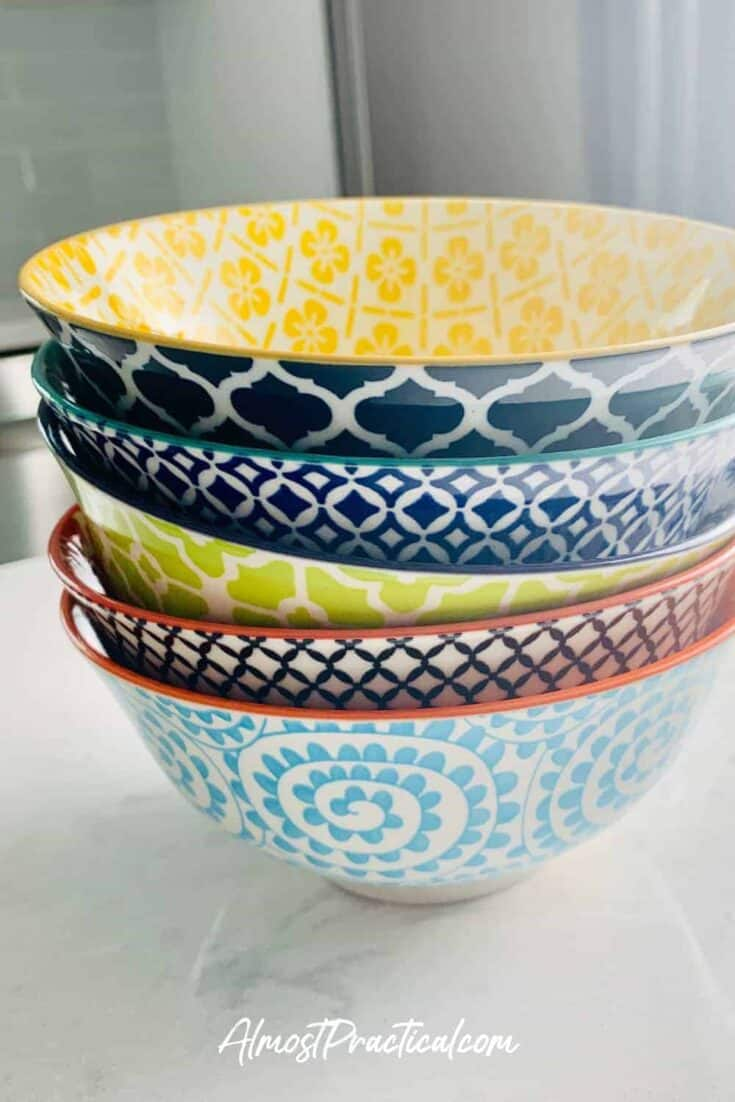Stack of colorful ceramic bowls.
