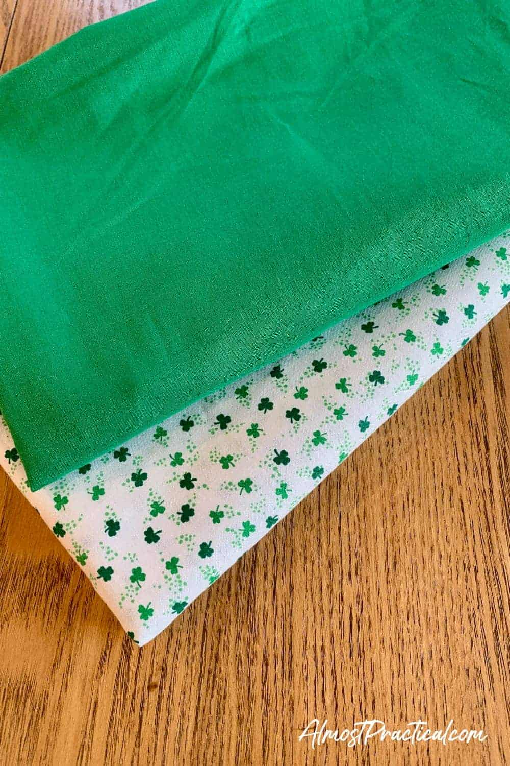 kelly green fabric and white fabric with shamrocks